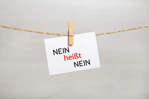 "Note with the inscription ""No means no"" hangs on a string"